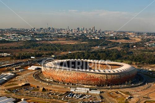 AFRIPICS - Soccer City Stadium with the city of Johannesburg